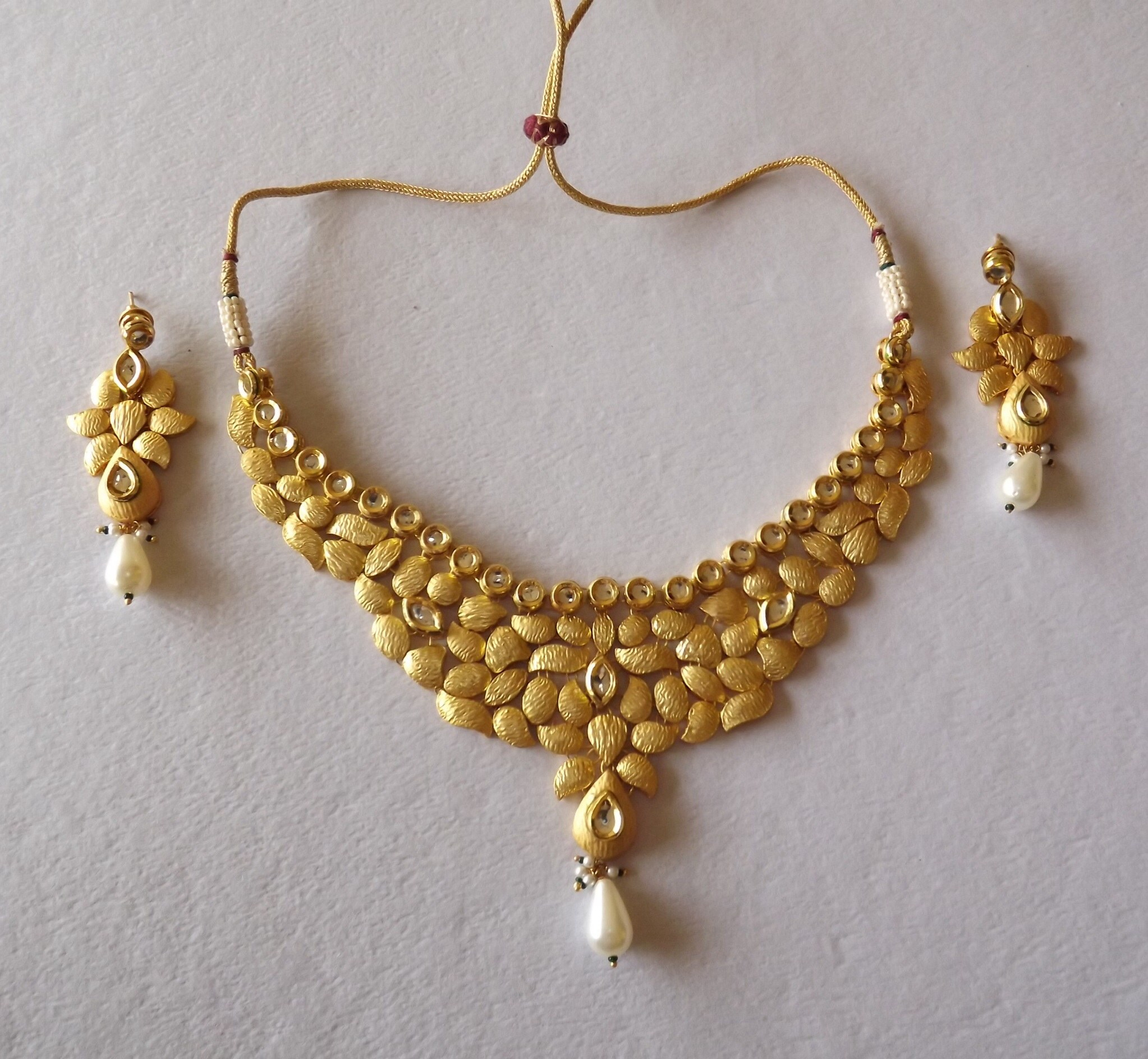 Photos of gold necklace Royalty Free Gold Necklace Pictures, Images and Stock Photos